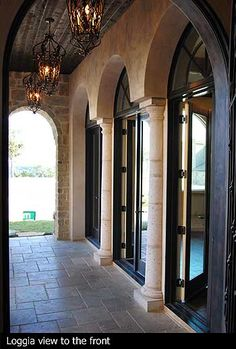 My three arch patio double doors! :) Except, the doors will match the front door (iron and glass door previously repinned). I love the ground tile, the stone patio enterance/exit walls, and the chandeliers.