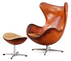An Arne Jacobsen brown leather 'Egg chair' with ottoman, by Fritz Hansen, Denmark 1963