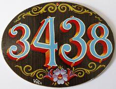 Numero de domicilio con fileteado porteño