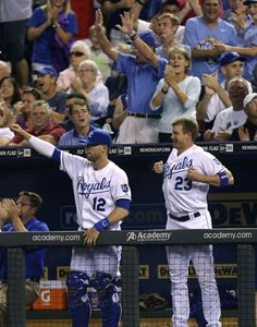 Brett Hayes #12 and Elliot Johnson #23 of the Kansas City Royals celebrate after teammate Justin Maxwell #27 hit a RBI single in the sixth inning during a game against the Boston Red Sox at Kauffman Stadium August, 9, 2013 in Kansas City, Missouri. (Photo by Ed Zurga/Getty Images)
