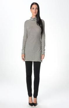 We love this Turtle neck tunic from Fluxus.  We have it in two color options black and white and rye and black.