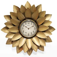 This is just a gorgeous clock. Metal, petal design. The Midas by Infinity Instruments #clock #new #decor #gold #art