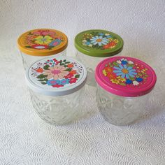 I'm wild about the flowers on these lids -- Etsy listing at https://www.etsy.com/listing/250963673/ball-jar-flower-power-1970s-quilted