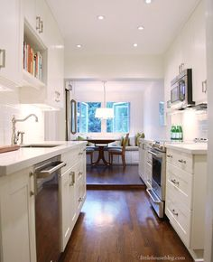 Tips & Tricks for Buying an Ikea Kitchen — Lindsay Stephenson - absolutely love the cookbook shelf over the sink. Lovely!