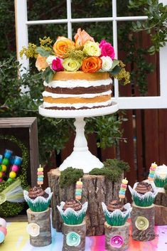 Flower topped layer cake at an Easter party! See more party planning ideas at CatchMyParty.com!