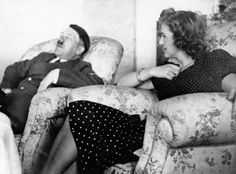 In a rare moment of repose, Adolf Hitler naps while his long-time mistress, Eva Braun, looks on. Hitler and Braun married the day before committing suicide together, just prior to the collapse of the Third Reich. World History, World War, Berchtesgaden Germany, Fidel Castro, Family Doctors, Iconic Photos, 2 Photos, Famous Couples, Military History