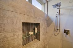 A Shampoo Revelle is a great idea to store products in the shower to reduce messiness.. it looks really good too!