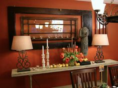 burnt orange paint color with dark accent furniture (ACCENT WALL COLOR) love the window in the door as wall art.
