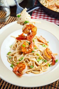 Cajun Shrimp Fettuccine Alfredo A creamy alfredo fettuccine spiced with cajun seasoning and served with blackened shrimp that makes for a quick and tasty meal for the family that is also sure to impress guests!
