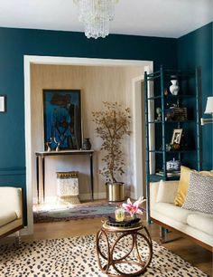 Moody Blue walls, cream furniture, cheetah carpet, cream trim. Also love the cream moire in the foyer beyond