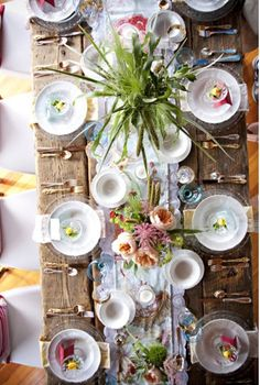 mix matched silverware is always a nice touch to a vintage party table