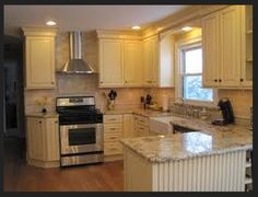 change to U-layout, by adding penninsula, with chimney hood and crown molding