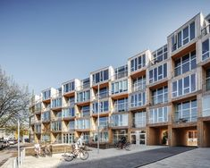 The prefab building hosts 66 new apartments. Tagged: Exterior, Wood Siding Material, Apartment Building Type, and Flat RoofLine. Photo 2 of 15 in This Curving Prefab Building in Copenhagen Contains 66 Affordable Apartments. Terrace Building, Building Exterior, Building Design, Building A House, Building Facade, Building Ideas, Building Plans, Sustainable Architecture, Residential Architecture