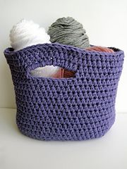 This basket has an oval shaped base and handles. It is worked up using two strands of yarn held together. It perfect for storing your yarn and WIPs.