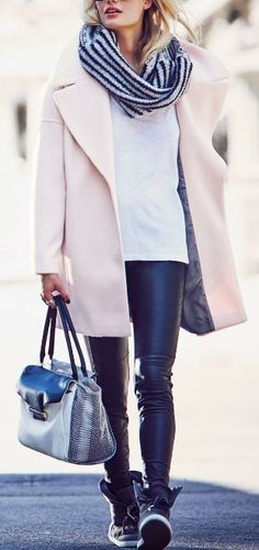 Want this whole look! Love the contrast of the pastel Calvin Klein coat along with the leather leggings!