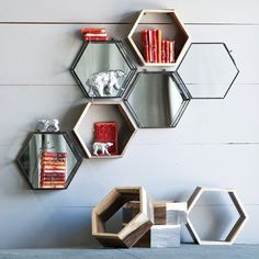 """The hexagonal Eco Honeycomb Shelves aremade from repurposed furniture production remnants. Designed to be wall mounted with two simple screws, but works well as a contemporary accent on bookshelves and tabletops around your home. Order is for one hexagon shelf. Shelf measures 10¾"""" x 10¾"""" x 3⅞"""" Please allow 5-10 days for shipping."""