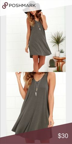Charcoal gray swing dress Super cute and comfy gray swing dress. V-neckline. Pair with cropped leather jacket and booties for a perfect transitional fall look! Lulu's Dresses Mini