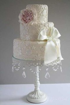 Stunning Shabby Chic Wedding Cake..  upcycle cheap cake plates from charity shops with crystals and pearls and lace