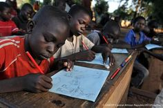 At a Child-Friendly Space in Bossangoa, Central African Republic, displaced children participate in a drawing session to manage distress from the conflict. Plan Canada, Childrens Artwork, Card Companies, Play To Learn, Insight, African, Culture, How To Plan, Learning