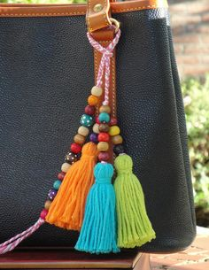 Playful Bag Charm, Tote charm, Tassels and wooden beads charm ** Tassel & Wooden bead Bag Charm ** Colorful bag accessory is handmade. ** Attach to a purse, straw bag or tote for an instant sensation Total Length : Approx. 22 PLEASE NOTE : Color of wooden bead may vary on each
