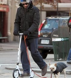 The cold weather doesn't keep Hugh Jackman from scooting.or walking the dog! Hugh Jackman, Hugh Michael Jackman, Micro Scooter, E Scooter, Broadway Stage, Star Wars, Dog Walking, Wolverine, Cold Weather