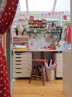 Cheerful sewing studio -  I would LOVE to get some of these cabinets from IKEA.  They would be perfect to put under my sewing table where I have so much wasted space.. then a couple more to go under the cutting table