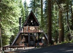 This A-frame cabin was re-imagined by Littrell Architecture Interiors. Discover Homewood – marvel at this A-frame cabin's sleek kitchen A Frame Cabin, A Frame House, Style At Home, Lac Tahoe, Steel Framing, Mid Century Exterior, Kabine, Cottage, Traditional Exterior