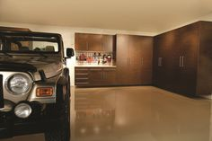 Earth tone flooring and cabinets makes this space more than a garage from Tailored Living powered by Premier Garage