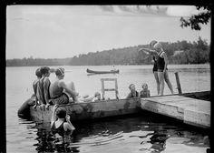Red Cross instructor teaching children how to swim, c. 1925, Worcester Massachusetts. Photograph from the E.B. Luce Collection. Want a copy of this photo? Visit our rights and reproductions page for more information. #Worcester #WorcesterHistory #WorcesterMa #1920s #EBLuce #Photography #Summer #Swimming #Dock #Canoe #Lake #History #GirlScouts #RedCross #NewEngland #AmericanHistory
