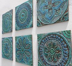 Mandala garden decor #5 made from ceramic.  These wall hangings are carved in deep relief using the highest quality earthenware . Our ceramic tiles are