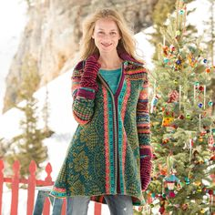 "ALPINE LEGENDS CARDIGAN -- Nordic designs from the highlands in street-ready style. Long wool zip cardigan features back-kick pleat to reveal contrasting pattern. Zipper front. Roll sleeves for contrasting color. On-seam pockets. Extra fine wool. Hand wash. Imported. Exclusive. Sizes S (2 to 4), M (6 to 8), L (10 to 12), XL (14). Approx. 33-1/2""L."