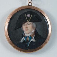 Portrait Miniature of a French Officer Wearing a Tricorne Hat with Tricolor cockade, Circa 1790 - Watercolor on ivory in circular format, diameter 3 inches. In pendant case, the reverse with portrait of a woman in lace cap.