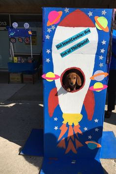 A clearer shot of our rocket ship photo booth (with puppy to up its cute factor a few more notches) that accompanied our booth #girlscoutcookies #blingyourbooth