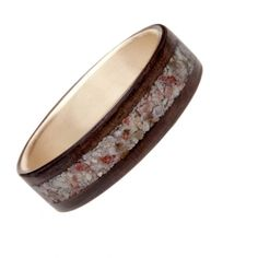 Northwood Indian Rosewood with 14k Yellow Gold Linger and Coral Sand Inlay, $495; northwoodrings.com   - ELLE.com