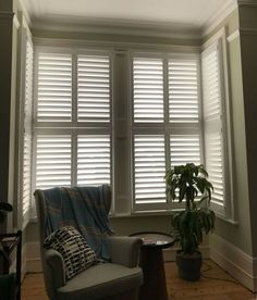 Tier on tier shutters without a tilt rod fitted to a cozy box bay window corner Bay Window Shutters, Wooden Shutters, Wooden Curtain Poles, Motorized Blinds, Made To Measure Blinds, Tilt, Carpentry, Corner, Cozy