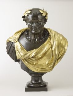 Located 2015 in the Picture Gallery of Buckingham Palace, London, UK. A French bronze portrait bust of the Roman Emperor Vespasian (AD 9-AD 79) wearing armor. The Gilt bronze laurel wreath at the temples & Gilt bronze draperies were separately cast & applied. Sent to King George IV (1762-1830) UK, Uncle of Queen Victoria (1819-1901) UK in 1828.