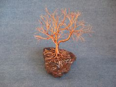 Copper on granite - A twisted wire tree sculpture.. $34.00, via Etsy.
