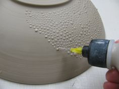 Texturize lamp bases and other surfaces with hot glue, metallic paint, etc.