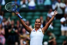 Dominika Cibulkova of Slovakia celebrates after winning her Ladies' Singles first round match against Aleksandra Wozniak of Canada on day one of the Wimbledon Lawn Tennis Championships at the All England Lawn Tennis and Croquet Club at Wimbledon on June 23, 2014 in London, England. (Photo by Matthew Stockman/Getty Images)