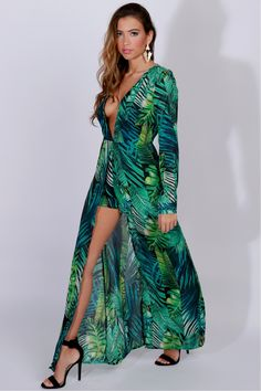 Palm Leaf Print Maxi Green, A leaf print romper with a maxi skirt overlay with a complete open front, long sleeves, a v-cut neckline, button closure wrist, and zipper closure along the back.