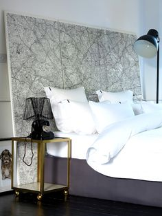 Map headboard. Love this idea! Not too fond of the  topographic map look though. I'd probably have a world map. :)