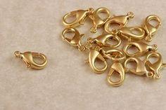 Fornitura cierre mosquetón chapado en oro de 22k. para usar en joyería y alta bisuteria.