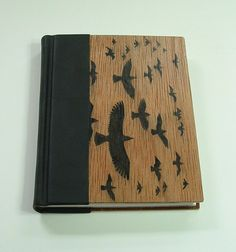 Handmade book, a work of art, bound in black calfskin and wood, with original block print art on cover. Journal, diary, sketchbook.