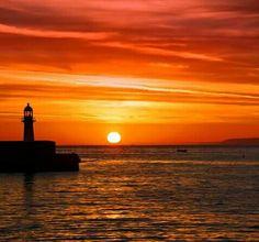 St Ives Harbour lighthouse sunset. Cornwall, UK