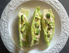 Lettuce boats for the Mister filled with pink salmon mixed with mayo topped with avocado. Not pictured is all the Chalula hot sauce  (16grams of protein) I had the same thing except with shredded chicken (9 grams of protein). #keto #diet #lowcarb #ketogenics #ketogenicgirl #highfatlowcarb #healthy #homecooked #ketosis #ketodiet #ketolife #ketofood #beginner #ketolifestyle #ketogenicdiet by greeneggsendsam