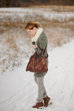 Lovely sweater and leather bag.