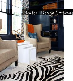 Living Room Blue Orange Picture......grey walls instead with teal instead of blue :) Love the neutral chairs