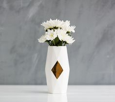 Brighten up any space with your favourite flowers in this faceted Vase.