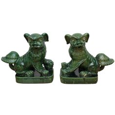 Large Pair Chinese Pottery Foo Dogs | From a unique collection of antique and modern ceramics at http://www.1stdibs.com/furniture/asian-art-furniture/ceramics/