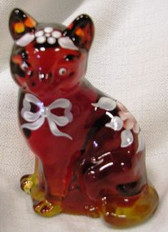 Fenton Solid Glass Sitting Cat is a Limited Edition of only 25 Pieces. It is Ruby and Handpainted with a Pink Rose Design.